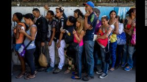 Hungry Venezuelans queue up for food scraps after socialist government collapse.