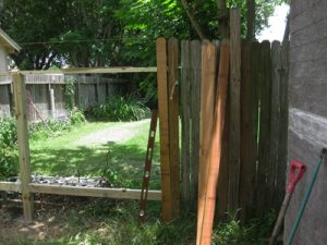 A partially-completed privacy picket fence.