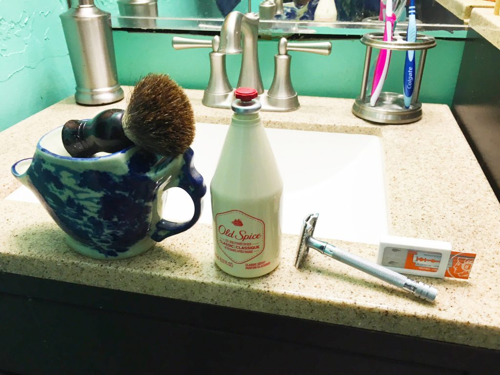 Shaving razor, brush, cup and soap - gear for manly grooming