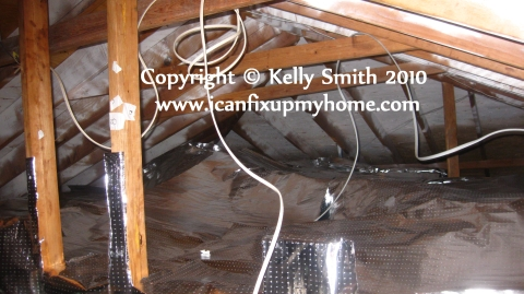 Radiant barrier foil in the attic.
