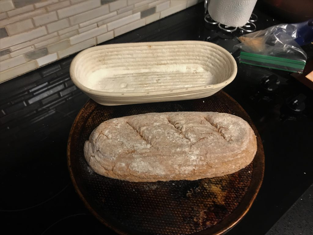 Loaf of bread with an oval Banneton proofing basket