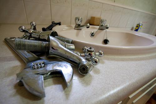 Disassembling a sink faucet for repair