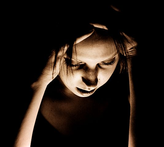 A woman suffering in pain