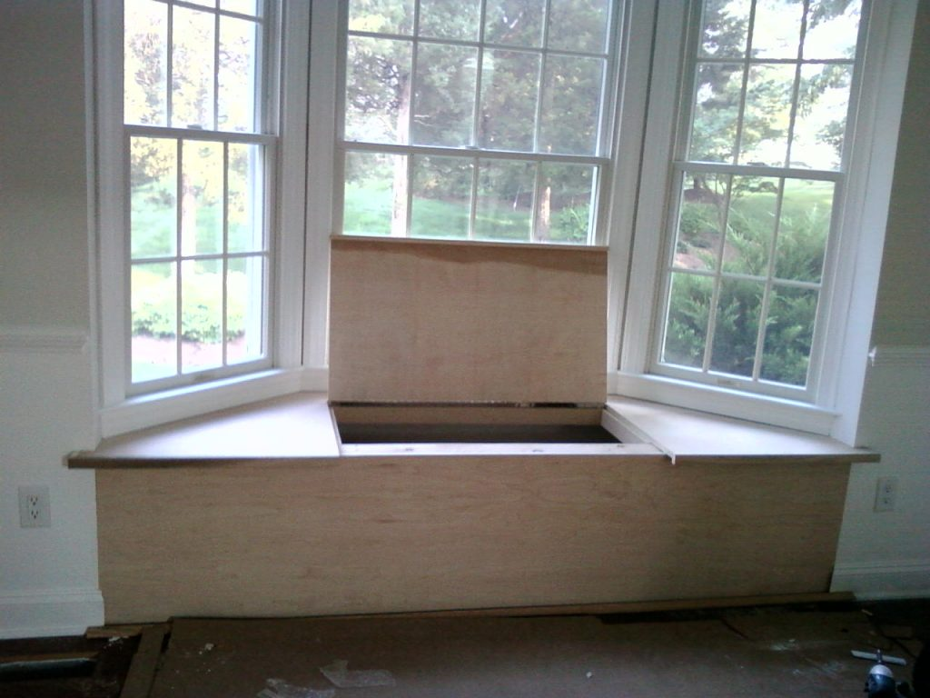 A bay window seat, with a hinged top, under construction