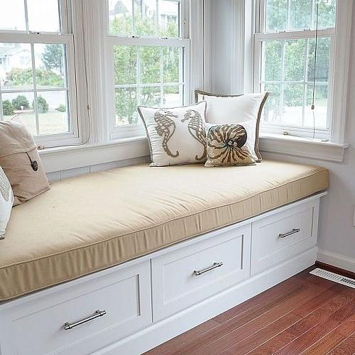 A bay window seat with storage drawers