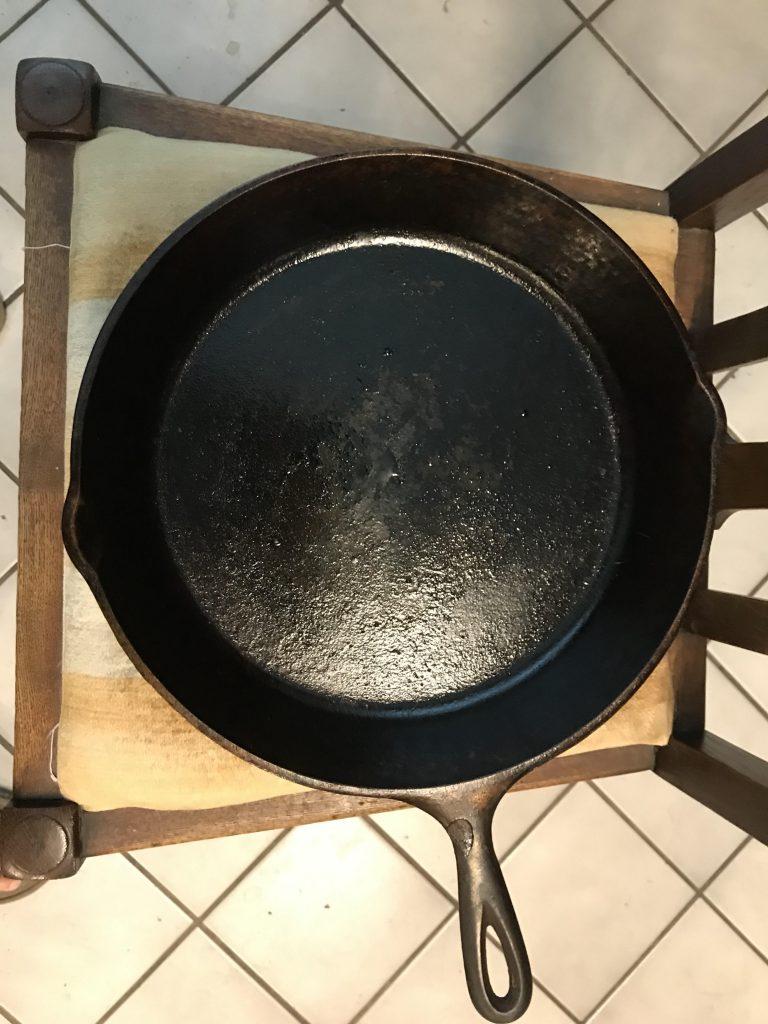 A freshly seasoned cast iron skillet