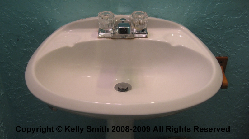 A bathroom pedestal sink