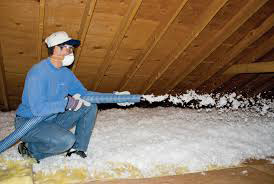 Installing blown-in cellulose insulation; photo courtesy Nancy Butler