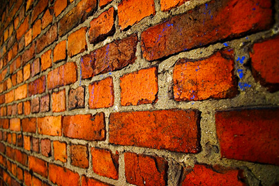 A brick wall needing mortar repair; photo courtesy Oula Lehtinen