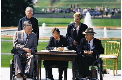 President Bush signs Americans with Disabilities Act of 1990