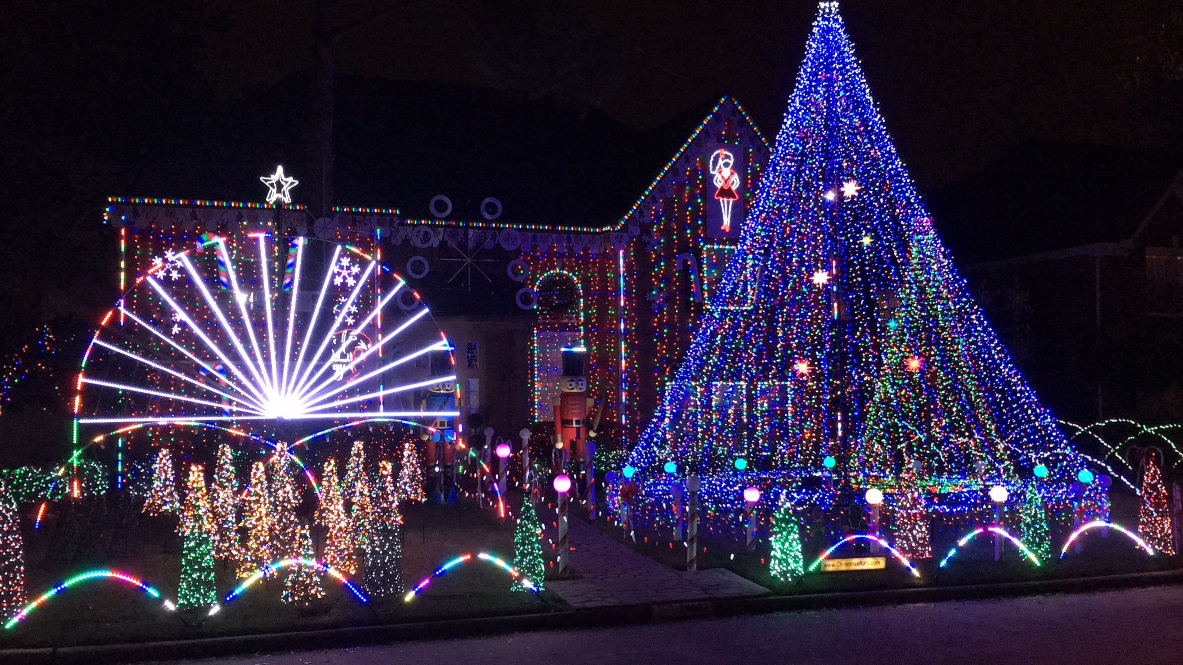 A plethora of Christmas lights on the front lawn
