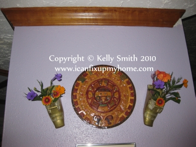 Spanish conquistadores stirrups with flowers as wall art, photo courtesy of Kelly Smith