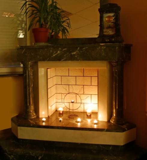 Decorate the fireplace with candles for living room ambiance