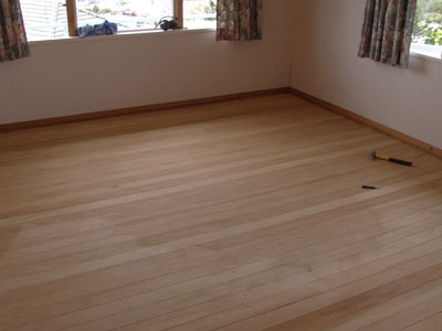 Refinishing a hardwood floor, photo courtesy Stug