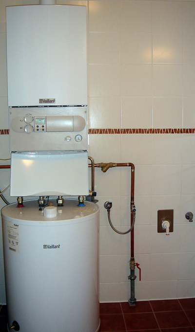 A typical tank hot water heater; photo courtesy Andy Butkaj