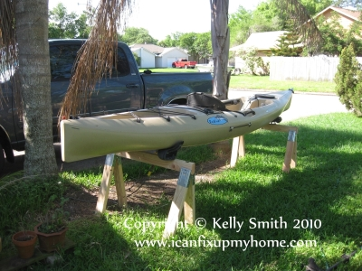 A cheap homemade kayak storage rack, by Kelly Smith