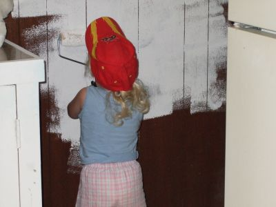 A Kid Painting Paneling