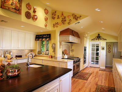 A kitchen with a yellow interior; photo provided by Sarah Harris