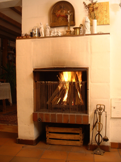 Open fireplace with icon; photo courtesy Klaus Mueller
