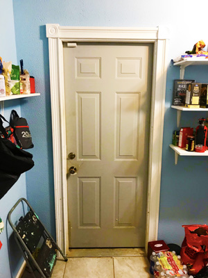 A pre-hung kitchen pantry door