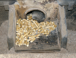 A compact pellet stove hopper with auger, photo courtesy Hustvedt