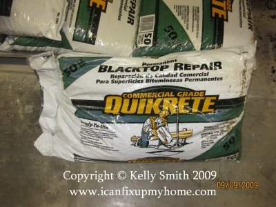 A bag of Quikrete Blacktop Repair Compound