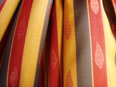 Red, yellow, and beige striped curtains, photo courtesy of Manik41
