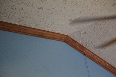 Red oak crown molding adds bling to your living room, photo courtesy of Kelly Smith