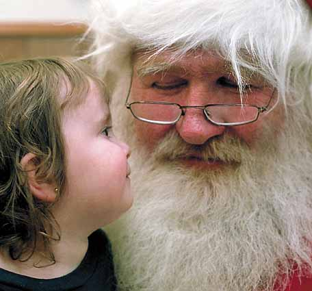 Santa Claus with a child; photo courtesy Jacob Windham
