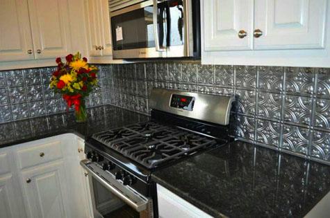 A kitchen tin tile backsplash